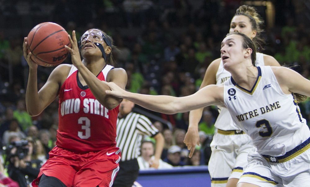 Notre Dame's Marina Mabrey, right, fouls Ohio State's Kelsey Mitchell during a 75-72 women's basketball win by the Irish Wednesday at South Bend, Ind.