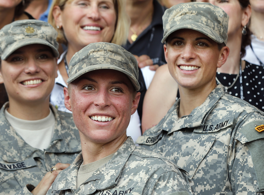 Army 1st Lt. Shaye Haver, center, and Capt. Kristen Griest, right, made history as the first female graduates of the Army's rigorous Ranger School.