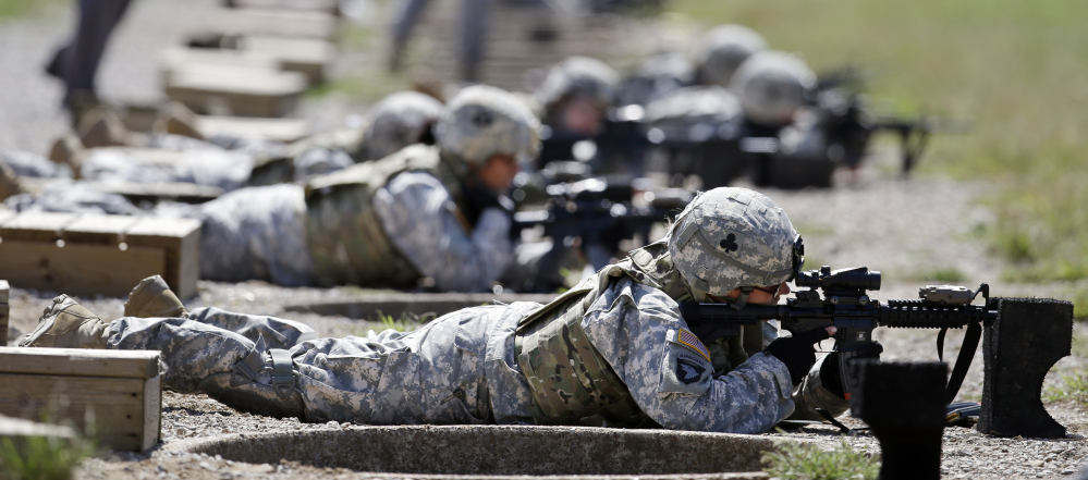 Female soldiers train on a firing range in Fort Campbell, Ky. All branches of the military have been ordered to open combat jobs to women.