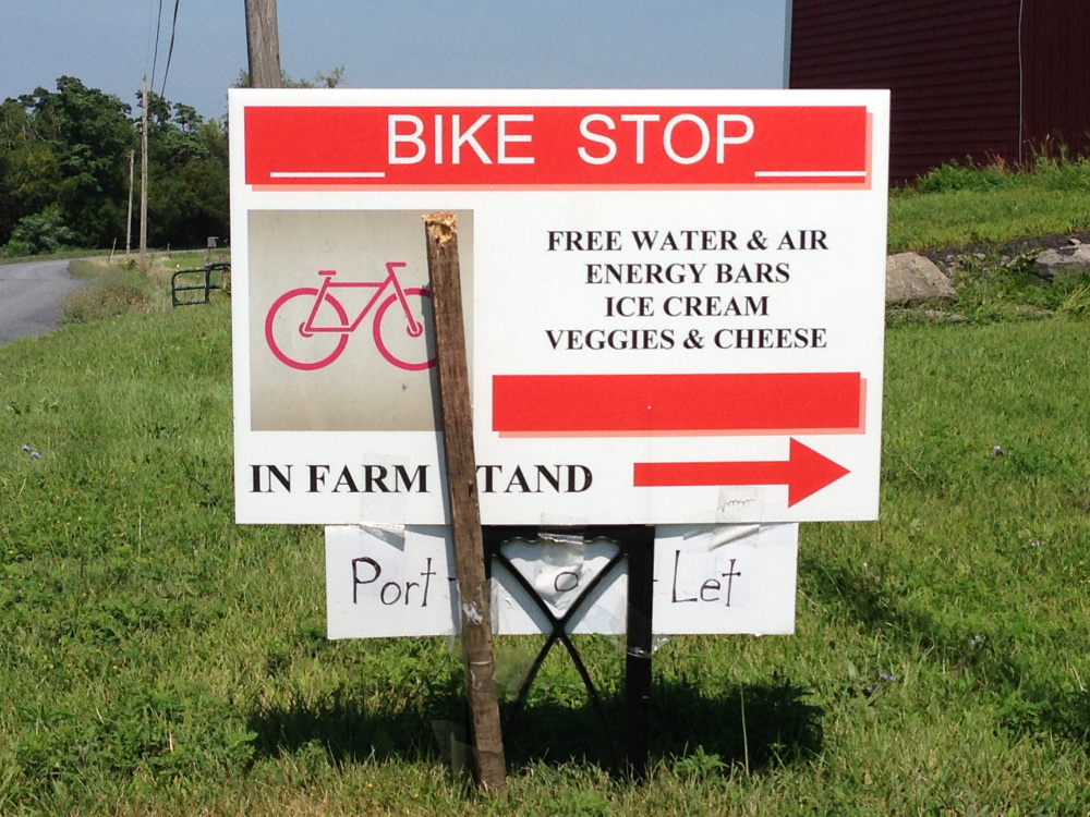 A sign by a farm stand in South Hero, Vt., invites cyclists to stop for free water and air for their tires, as well as snacks for sale. Maine's growing trail network could use signs directing cyclists to services nearby.