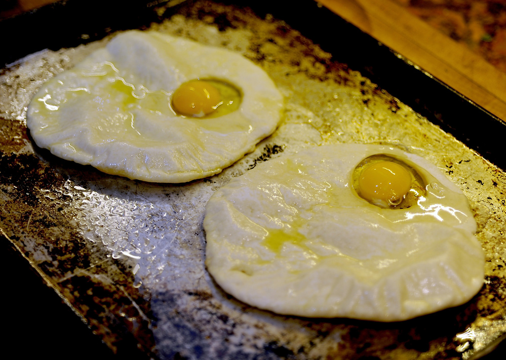 The flatbread is partially baked, then topped with an egg.