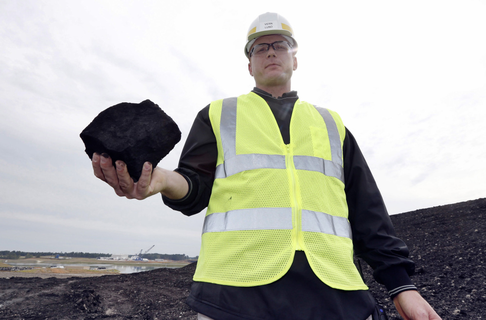 Vern Lund, president of Liberty Mine near DeKalb, Miss., holds coal that will eventually be burned in the Kemper County carbon capture power plant. The project, however, is way over budget and two years behind schedule.