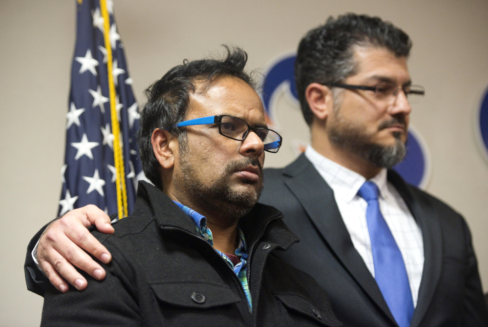 Farhan Khan, left, brother-in-law of one of the suspects in Wednesday's shooting,  and Hussam Ayloush of the Council on American-Islamic Relations hold a news conference Wednesday in Anaheim, Calif. Khan said he had no idea what might have motivated the attackers. Nevertheless, the San Bernardino killings are likely to trigger a backlash against American Muslims.