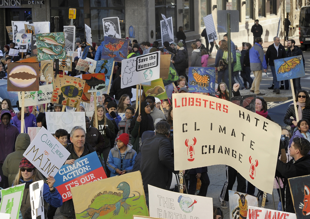 King Middle School students gather at Portland's City Hall Plaza this month to promote climate-change awareness.
