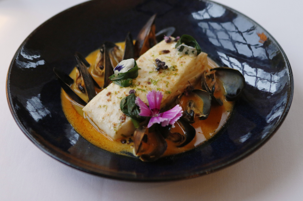 Steamed halibut with mussels.