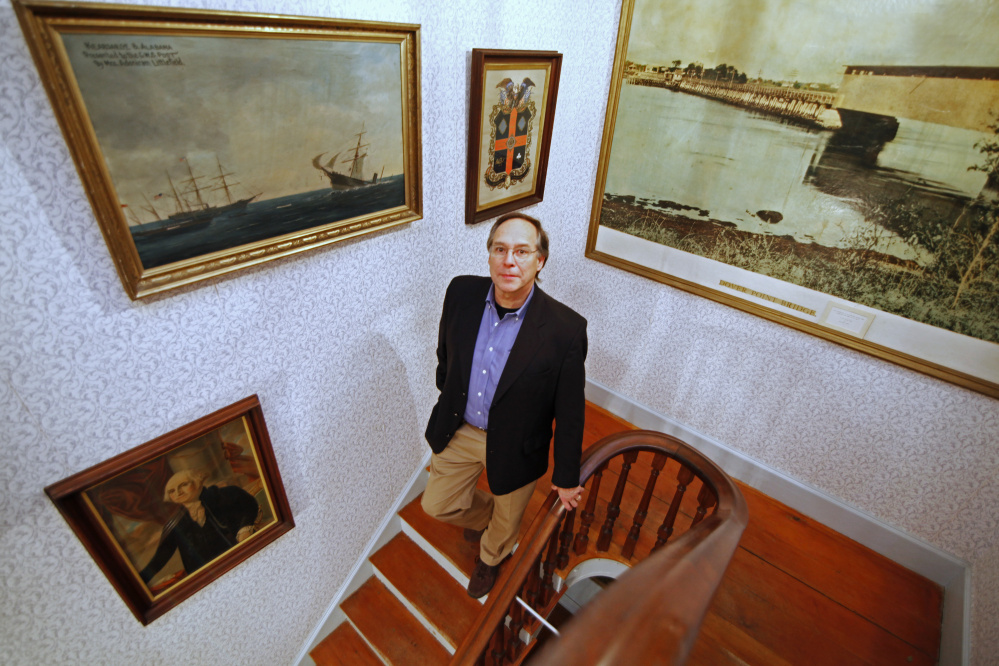 Wes LaFountain of South Portland is the new director at the Woodman Museum. Below: Butterflies from South America are part of a collection of 48 specimens at the museum.