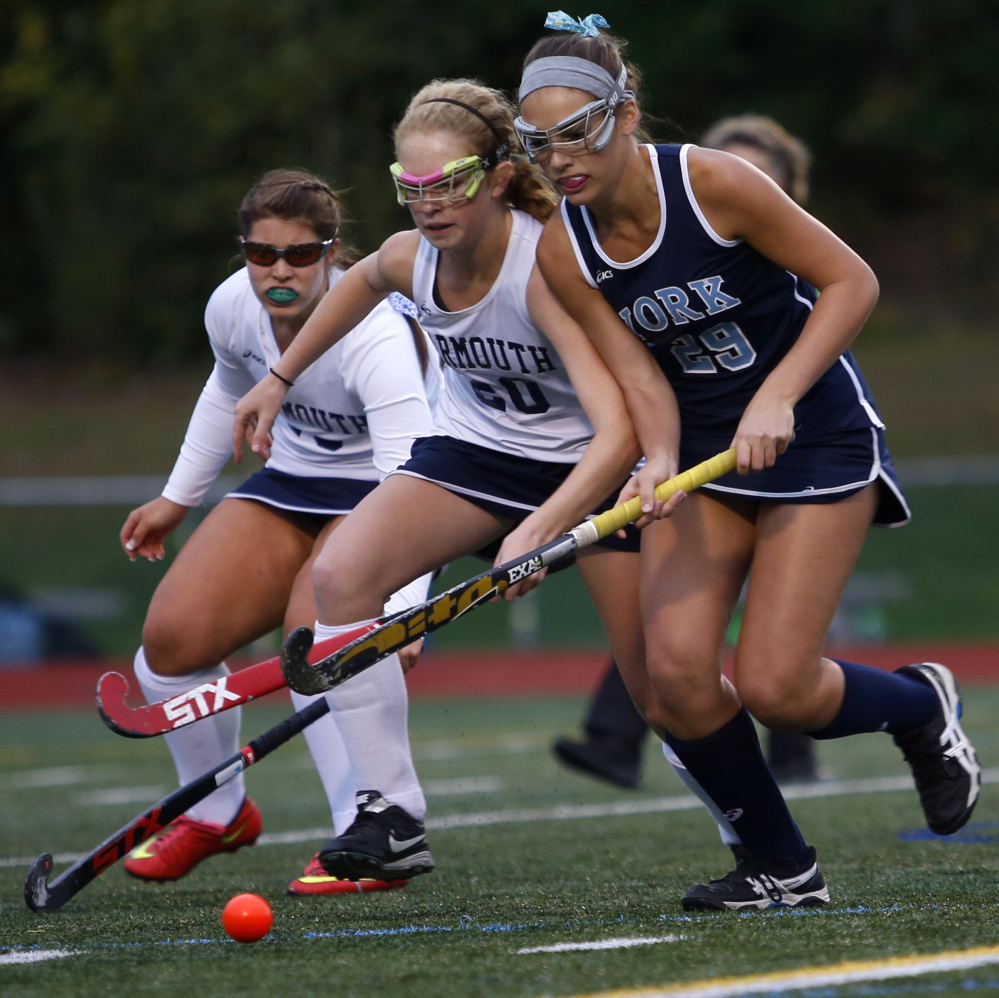 Lily Posternak, right, of York has made a verbal commitment to play field hockey at Duke University. The junior midfielder had 27 goals and 14 assists this fall.