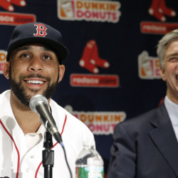 New Red Sox pitcher David Price smiles with President of Baseball Operations Dave Dombrowski at a news conference at Fenway Park announcing his signing of a seven-year contract worth $217 million.