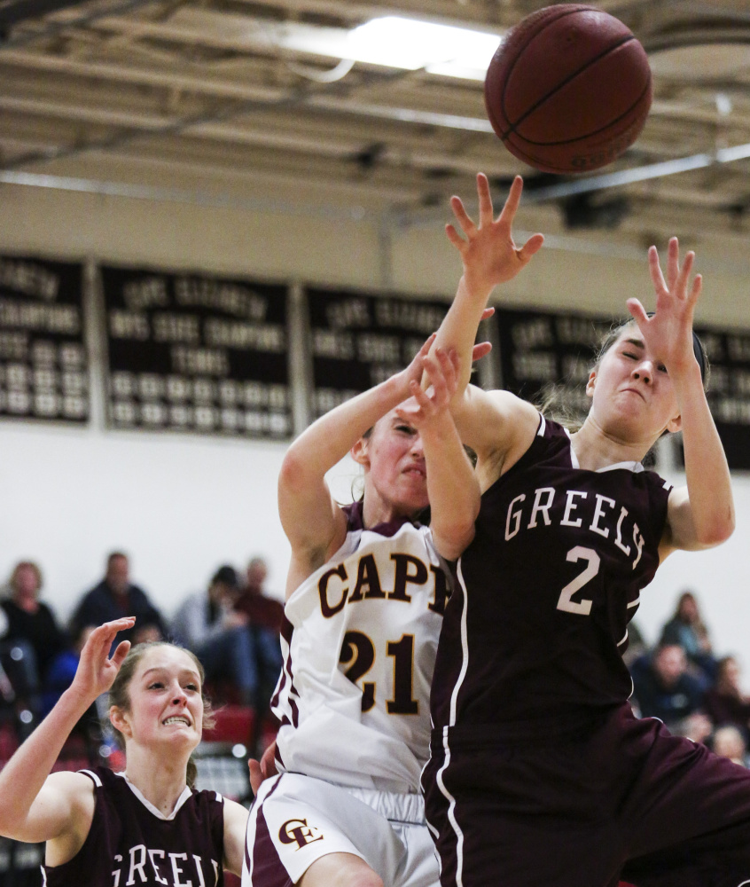 Isabel Porter of Greely, right, gets the inside position on Maddie Bowe of Cape Elizabeth to collect a rebound Friday night as Sarah Felkel of Greely moves in. Greely, the defending Class B state champion, pulled away to a 45-24 victory in its opener.