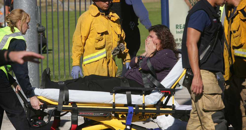 A victim is wheeled away following a mass shooting that killed 14 and injured 21 more at a social services facility Wednesday in San Bernardino, Calif. An average of 85 firearms deaths occur each day in the U.S.