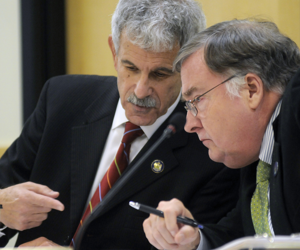 Sen. Roger Katz, R-Augusta, left, and Rep. Chuck Kruger, D-Thomaston, confer during a hearing about the governor's role in Speaker Mark Eves' losing a job at a charter school.