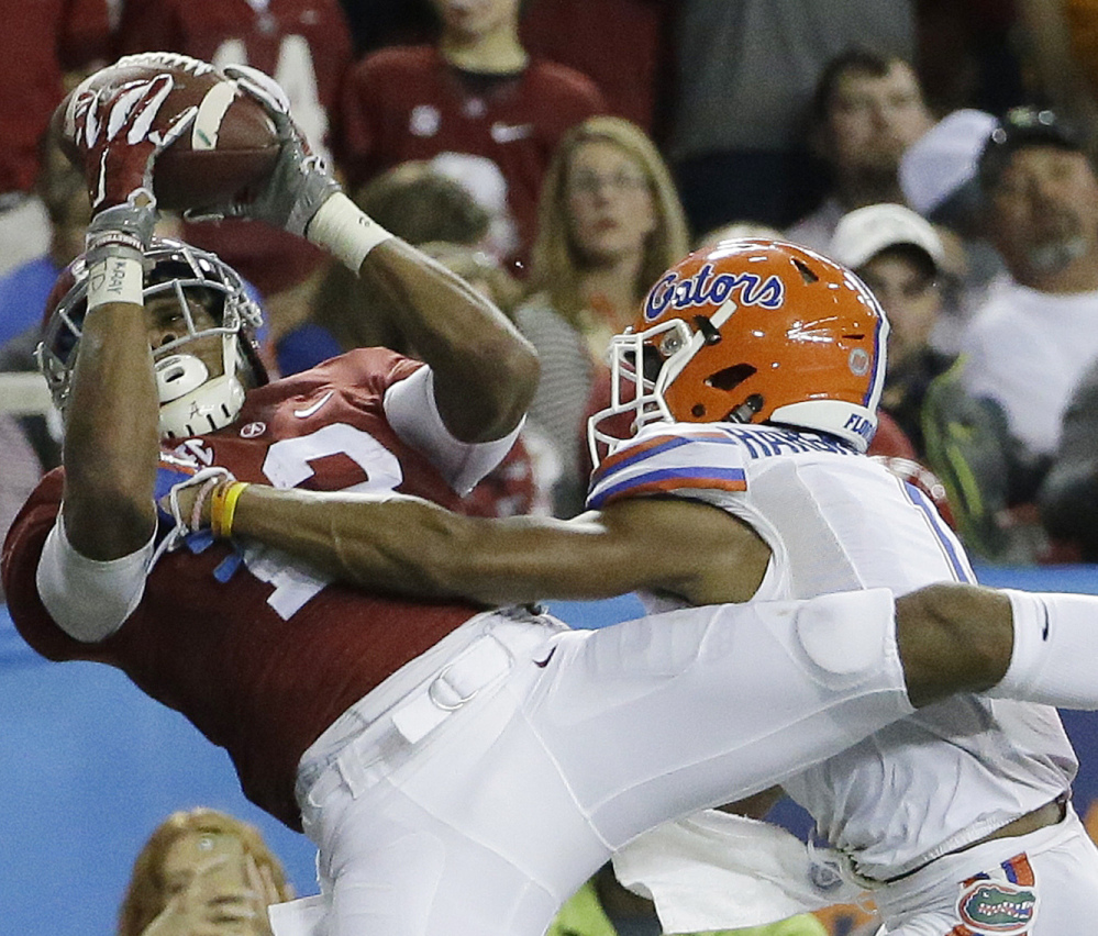 ArDarius Stewart of Alabama hauls in a touchdown pass Saturday while being defended by Vernon Hargreaves III of Florida during the second half of the Southeastern Conference championship game at Atlanta. The Crimson Tide rolled to a 29-15 victory.