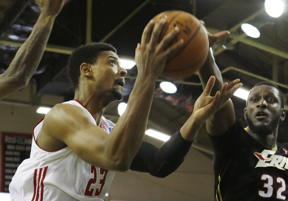 Jordan Mickey, left, scored 32 points and grabbed 13 rebounds to help the Red Claws to a victory over Nnanna Egwu, right, and the Erie BayHawks. Joel Page/Staff Photographer