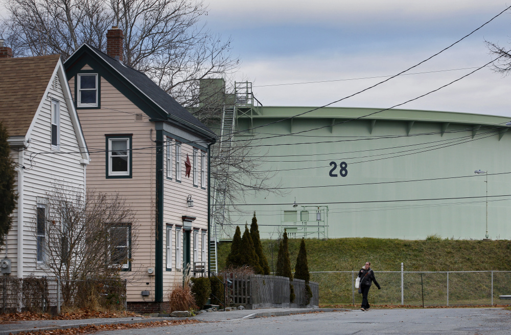 "Oil tanks loom in some of South Portland's neighborhoods, including Ferry Village. With the flow of foreign crude slowing, some wonder what the future holds for the waterfront. ""At some point we have to start thinking beyond the tanks,"" said City Councilor Claude Morgan."