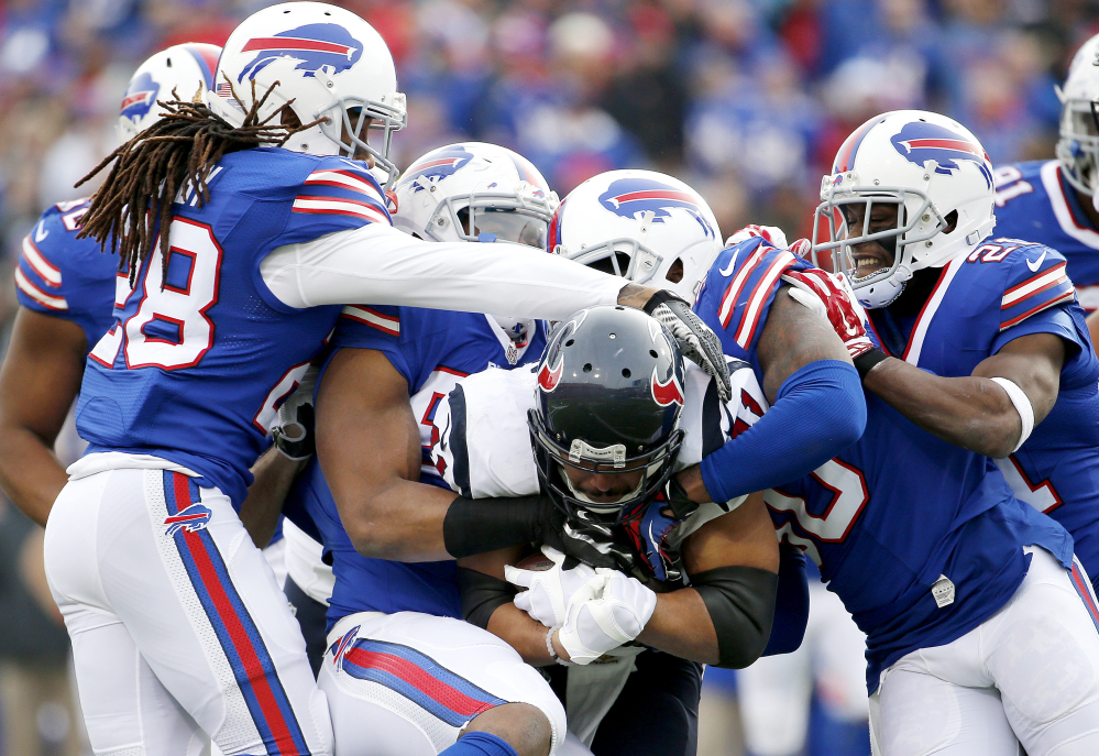 Texans running back Jonathan Grimes is gang-tackled by Buffalo defenders during the Bills' 30-21 victory Sunday in Orchard Park, N.Y.