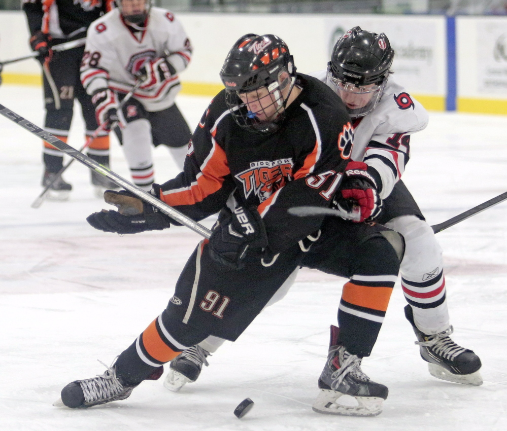 Ricky Ruck, left, and Biddeford will challenge Sean McDonald and Scarborough for supremacy in Class A. Scarborough won the Class A title last season.