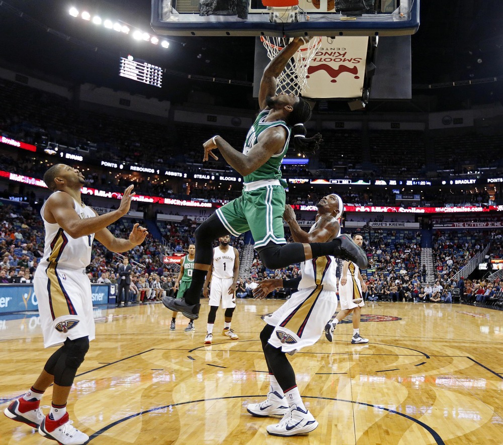 Celtics forward Jae Crowder drives to the basket in front of New Orleans Pelicans guard Eric Gordon, left, and forward Dante Cunningham in the first half of Monday night's game in New Orleans. Crowder scored 17 points in the game.