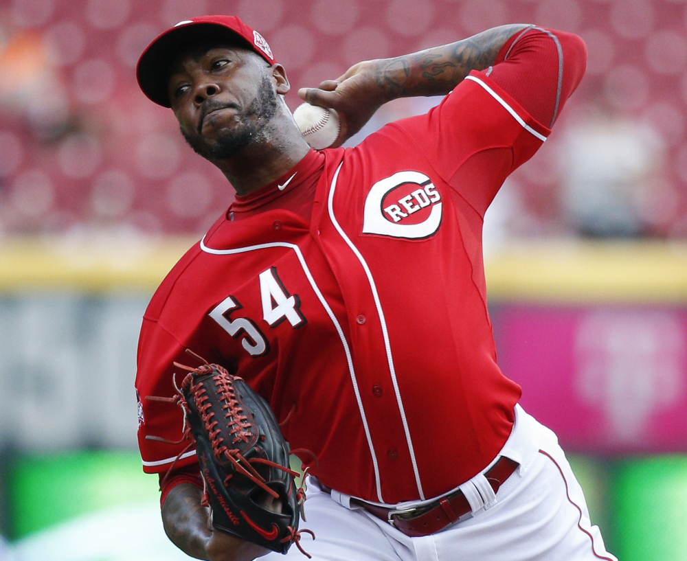 A trade that would have sent Reds closer Aroldis Chapman to the Dodgers on Monday is reportedly on hold after word of domestic violence allegations surfaced.