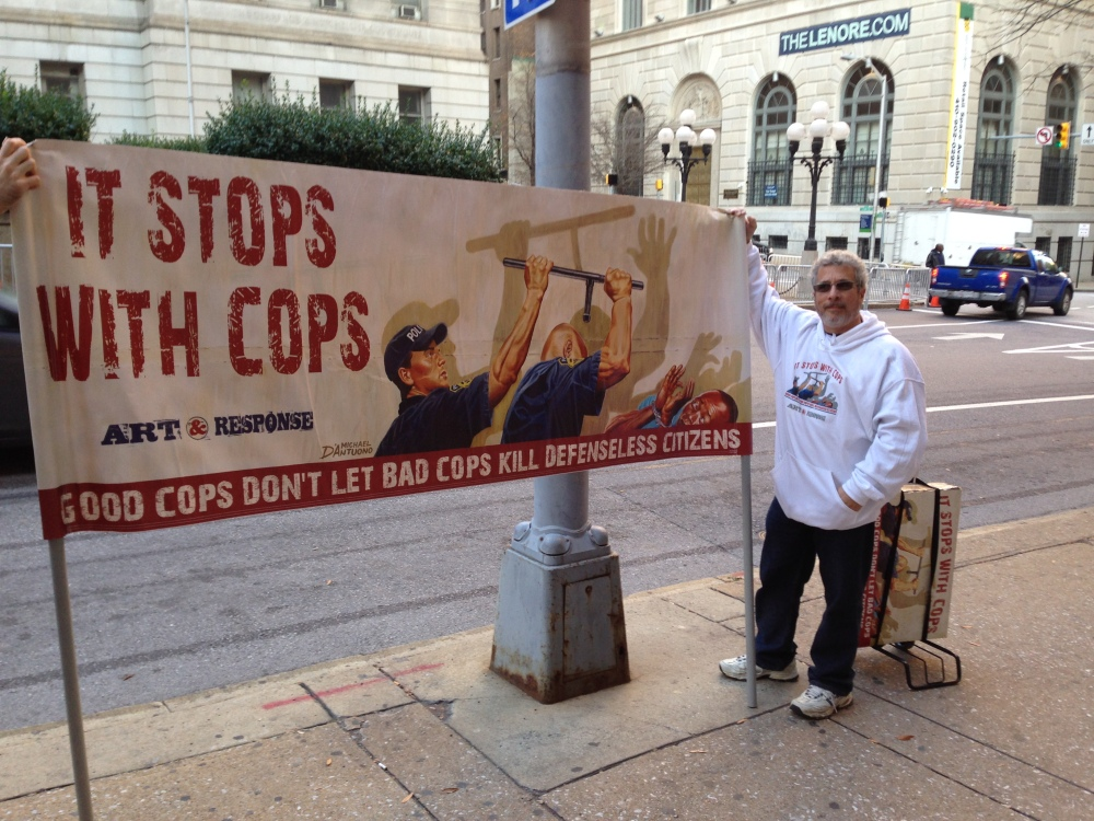 Michael D'Antuono of New York demonstrates outside the Baltimore courthouse where police Officer William Porter is on trial Tuesday for manslaughter in the death of Freddie Gray.