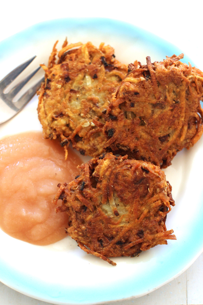 Classic latkes. This recipe by Alison Ladman is spiked with chipotle sour cream. (AP Photo/Matthew Mead)