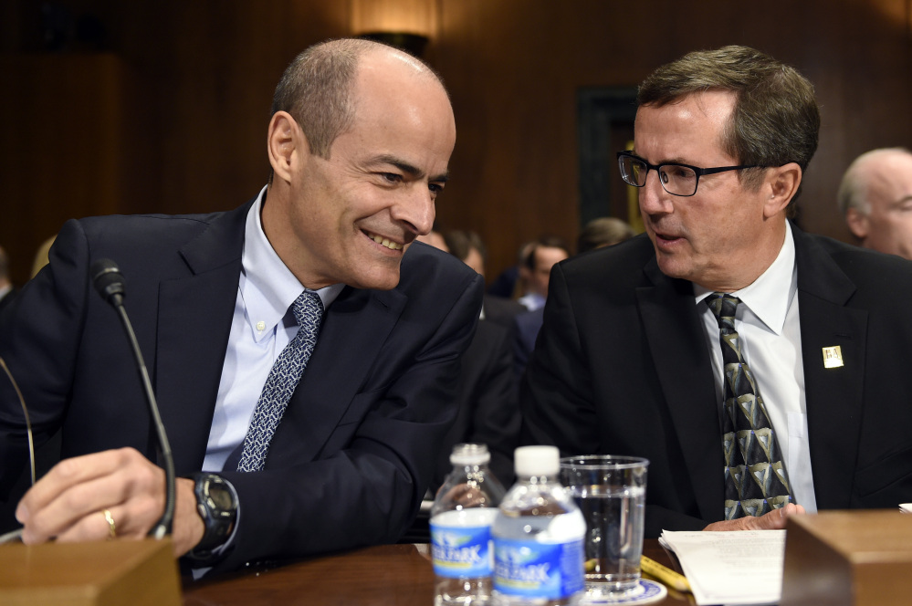 Anheuser-Busch InBev Chief Executive Officer Carlos Brito, left, told a Senate subcommittee that a merger with SABMiller will give the company access to key markets in Africa, Asia, Central and South America.