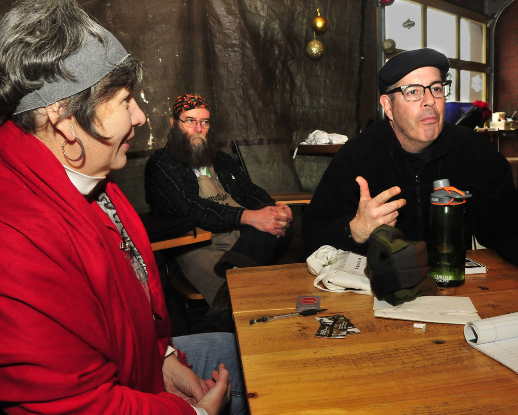 Sam Wells, right, of 168 Main Street Wood-Fired Pizza and Bakery explains his interest in baking during a workshop in Skowhegan on Tuesday. At left is Stacy Cooper of Biscuits and Company and Dusty Dowse of Maine Grain Alliance.
