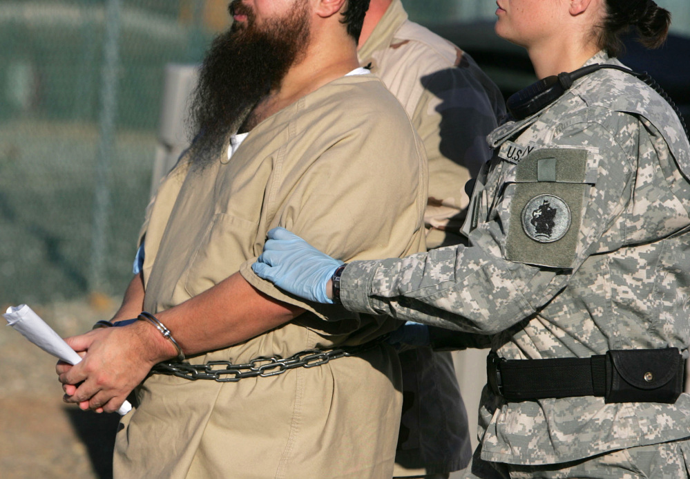 Muslim inmates said contact with unrelated women violates their religion. The ex-commander who ordered this at Guantanamo's Camp 7 hadn't previously run a detention center.