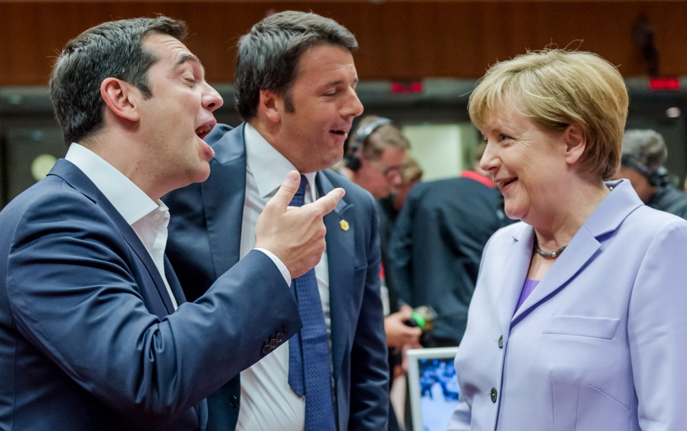 In this June 25, 2015 file photo Greek Prime Minister Alexis Tsipras, left, and Italian Prime Minister Matteo Renzi speak with German Chancellor Angela Merkel during a round table meeting at an EU summit in Brussels.