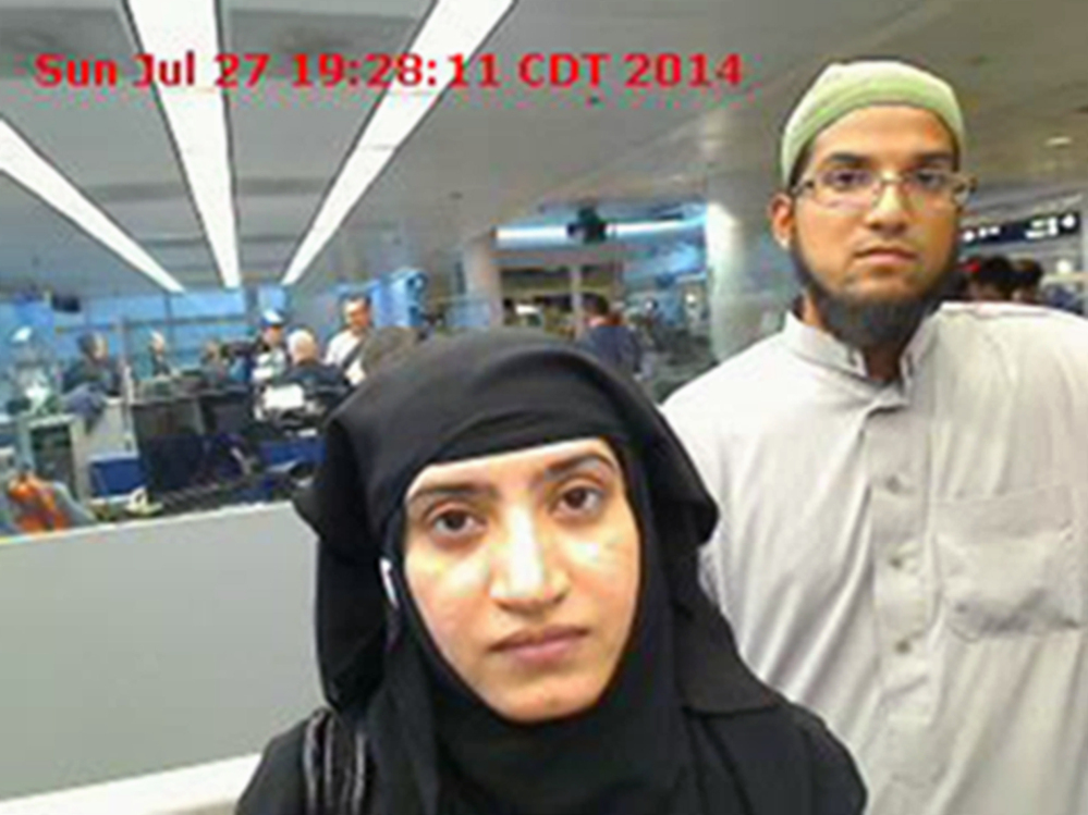 This photo provided by U.S. Customs and Border Protection shows Tashfeen Malik, left, and Syed Farook as they passed through O'Hare International Airport in Chicago on July 27, 2014.