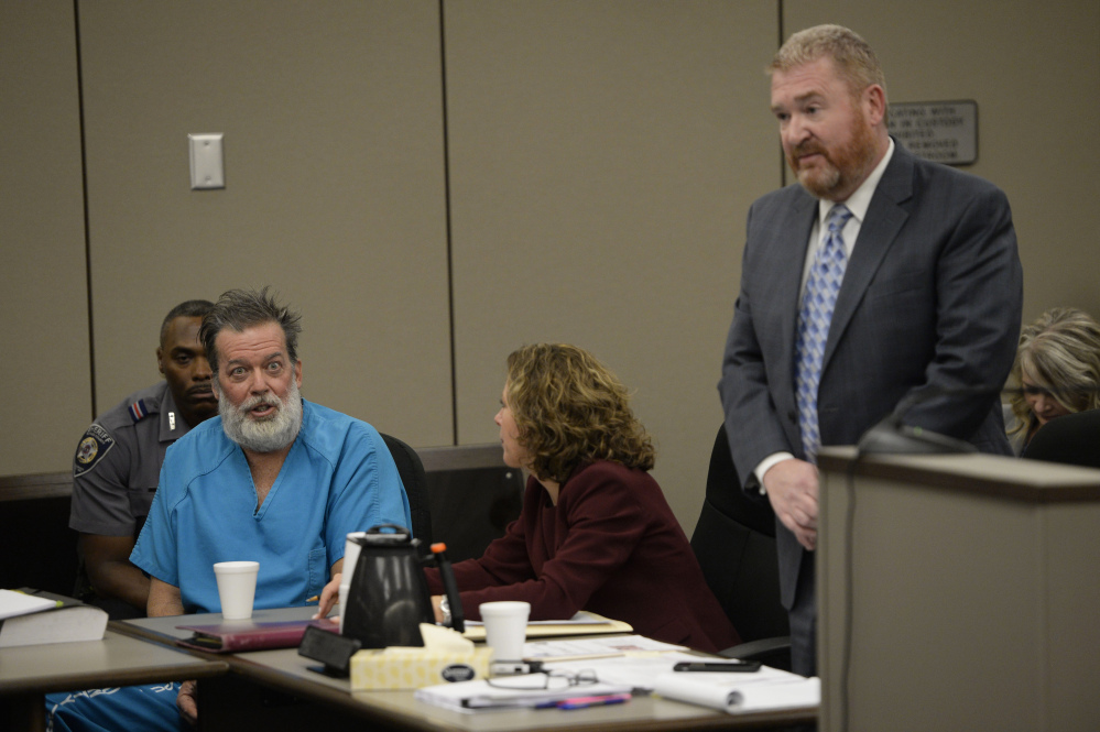 Attorney Rose Roy, center, tries to quiet Robert Lewis Dear during his outburst in court Wednesday while attorney Daniel King argues on Dear's behalf. Dear, accused of killing three people and wounding nine others at a Colorado Springs Planned Parenthood clinic on Nov. 27, was charged with first-degree murder. He repeatedly interrupted King during Wednesday's hearing, and objected to King's attempts to limit publicity in the case.