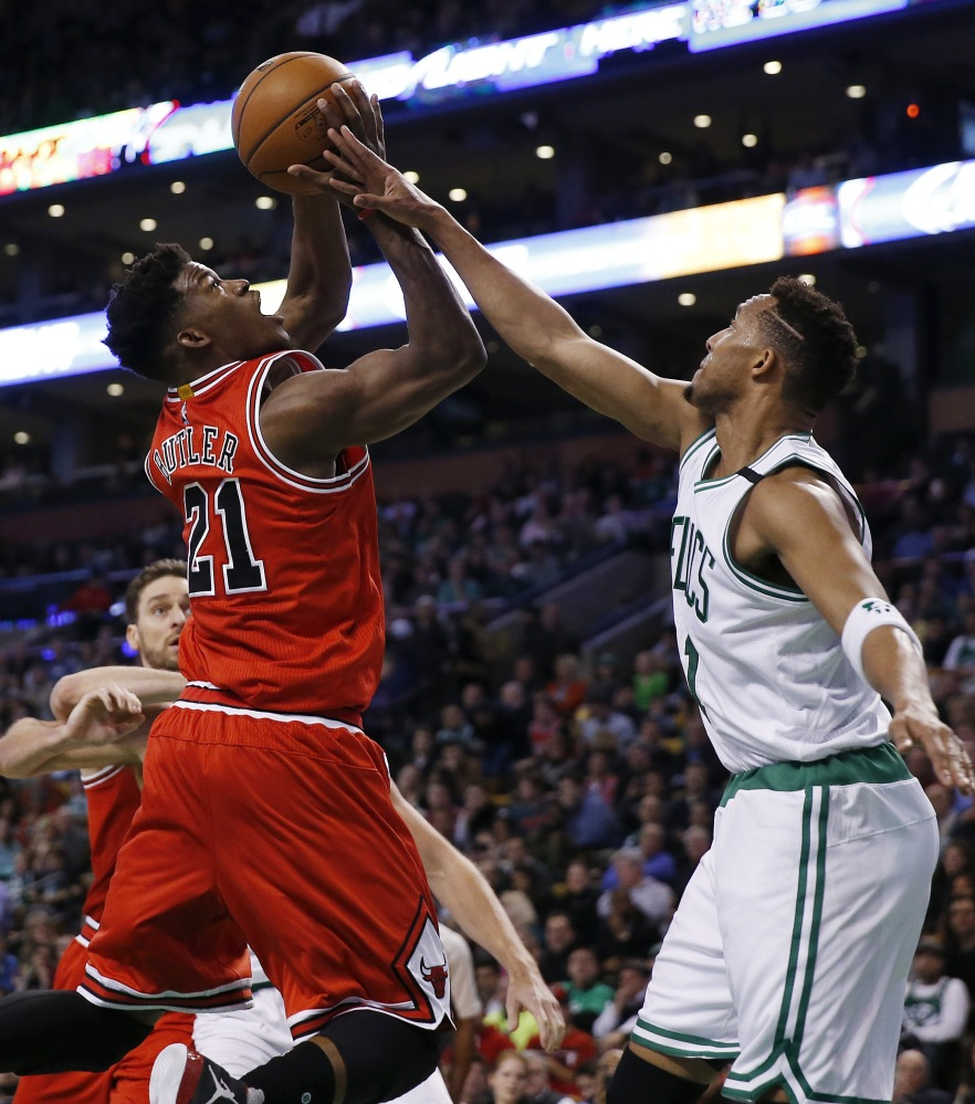 The Bulls' Jimmy Butler shoots against the Celtics' Evan Turner in the first half. Butler let the Bulls in scoring with a season-high 36 points.