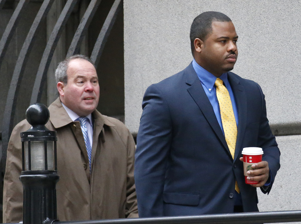 William Porter, right, one of six Baltimore city police officers charged in the death of Freddie Gray, told jurors Wednesday he didn't call a medic because he didn't have a reason to.