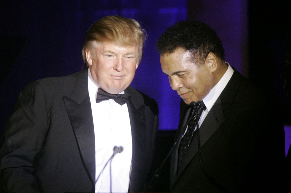 "Donald Trump accepts a Muhammad Ali award from Ali in 2007. Ali issued a statement Wednesday criticizing Trump's proposal to ban Muslims from entering the United States, and calling on Muslims ""to stand up to those who use Islam to advance their own personal agenda."""