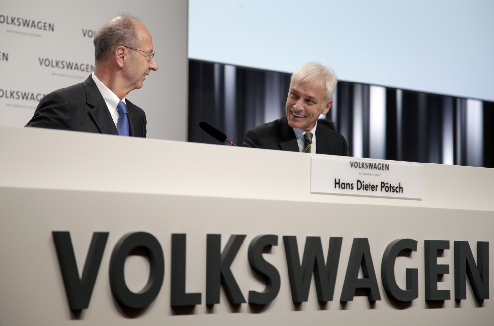 "Volkswagen Chairman Hans Dieter Poetsch, left, and CEO Matthias Mueller talk before a news conference in Germany on the company's investigation into emissions cheating. There was a ""chain of mistakes that was not interrupted at any point,"" Poetsch said."