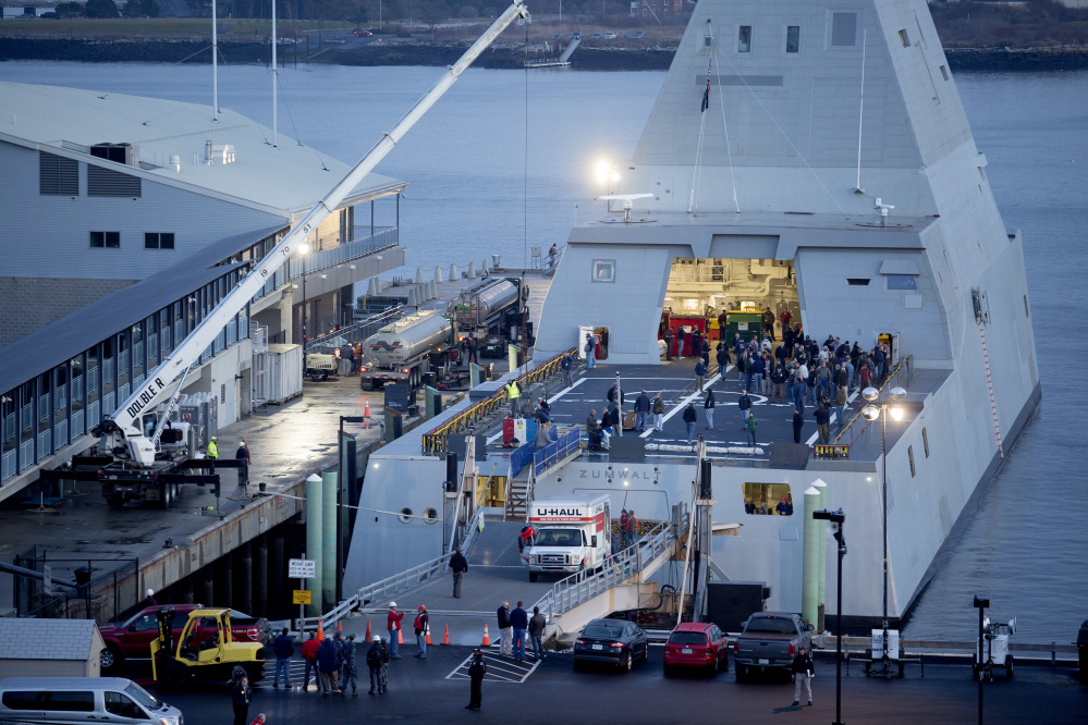 The USS Zumwalt, a guided missile destroyer, is loaded with supplies and other needs while its docked at the Ocean Gateway Terminal in Portland Thursday, December 10, 2015.