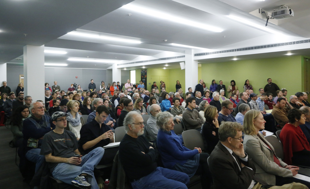 More than 100 people attend a forum to discuss city housing issues at the Portland Public library on Thursday.