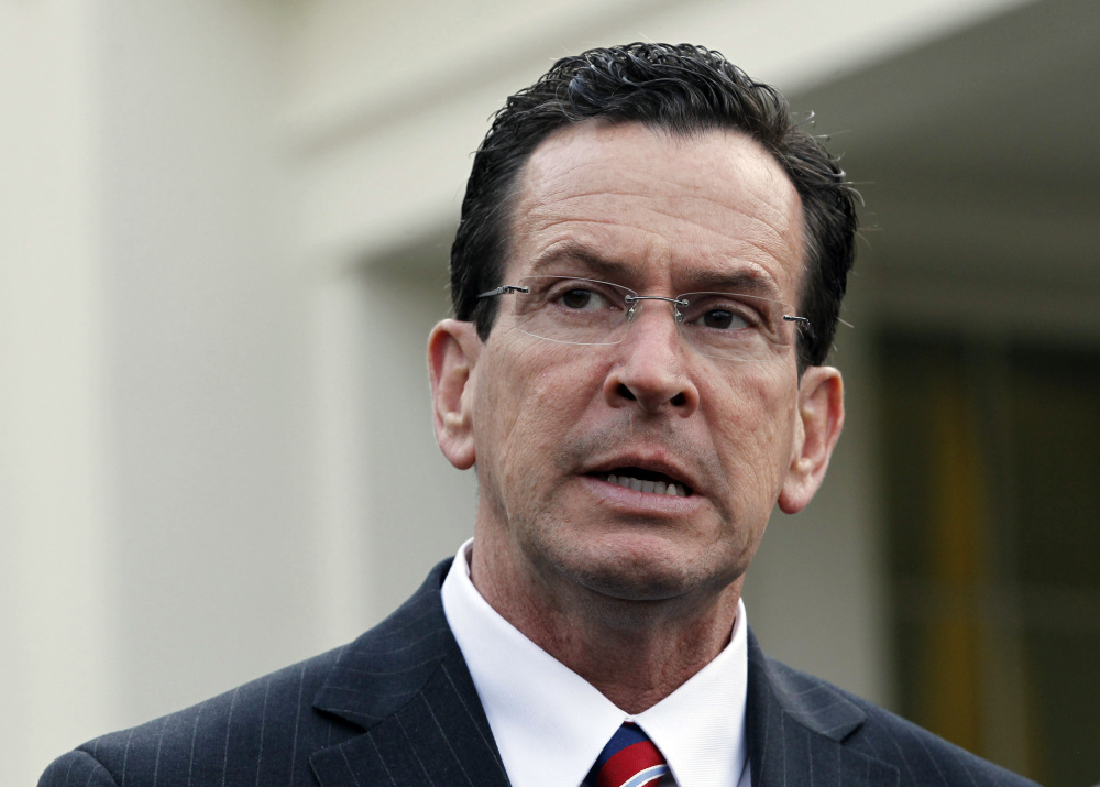"Connecticut Gov. Dannel P. Malloy said he's issuing an executive order to deny gun permits to people on federal watch lists because ""it's the right thing to do."" 2010 Reuters file photo"