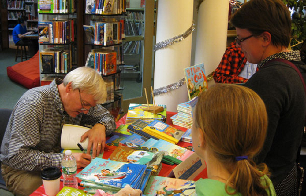 Children's author Chris Van Dusen signs copies of his book during last year's Ho Ho Holiday Book Fair at Camden Public Library. This year's event happens Sunday. Photo courtesy Ken Gross.