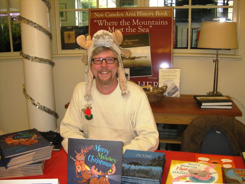 Children's author and illustrator Russ Cox poses during last year's Ho Ho Holiday Book Fair at the Camden Public Library. He will be on hand to sign copies of his book and meet with readers this Sunday. Photo Courtesy Ken Gross
