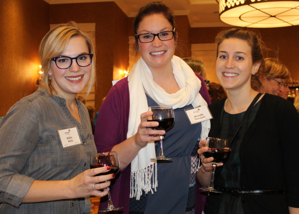 Emily White, left, Michelle Thompson and Sydney Mosher of event sponsor GarrandPartners.