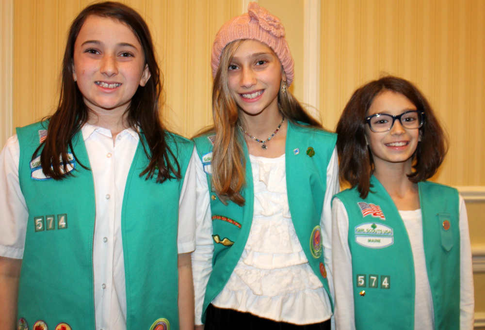 Lilly Theriault, left, Hannah Tardiff and Gwendolyn Catalano of Troop 574 in Westbrook.