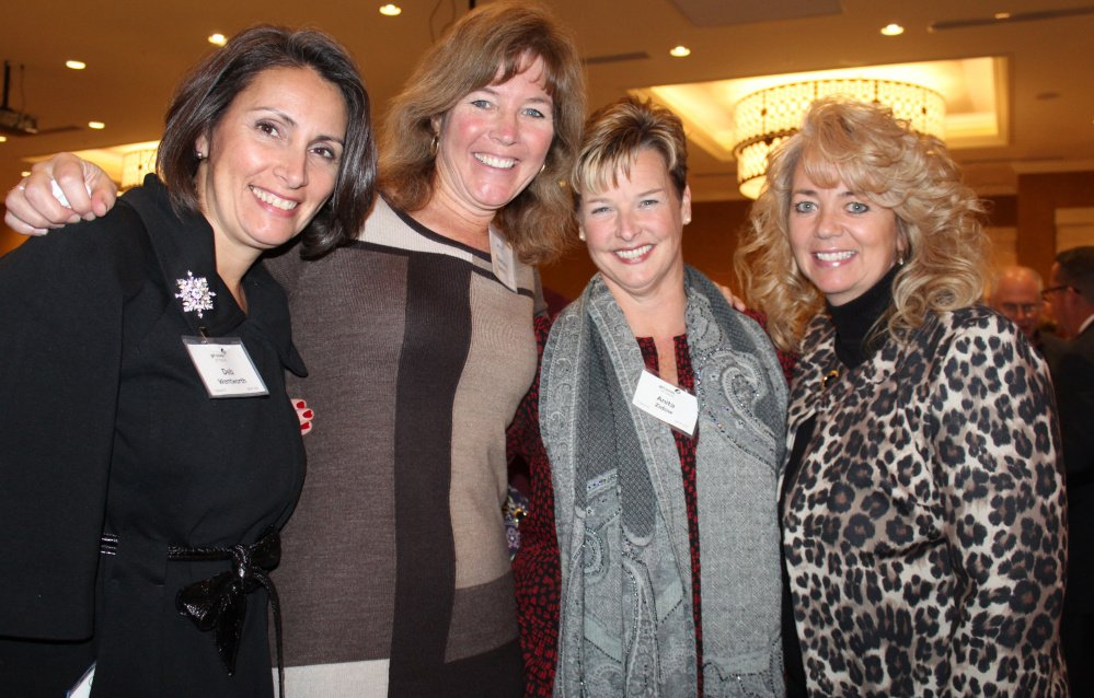 Deb Wentworth, left, Charlene Batista, Anita Zidow and Shannon Gorman at the event that raised $128,000 to help Maine girls take part in scouting.