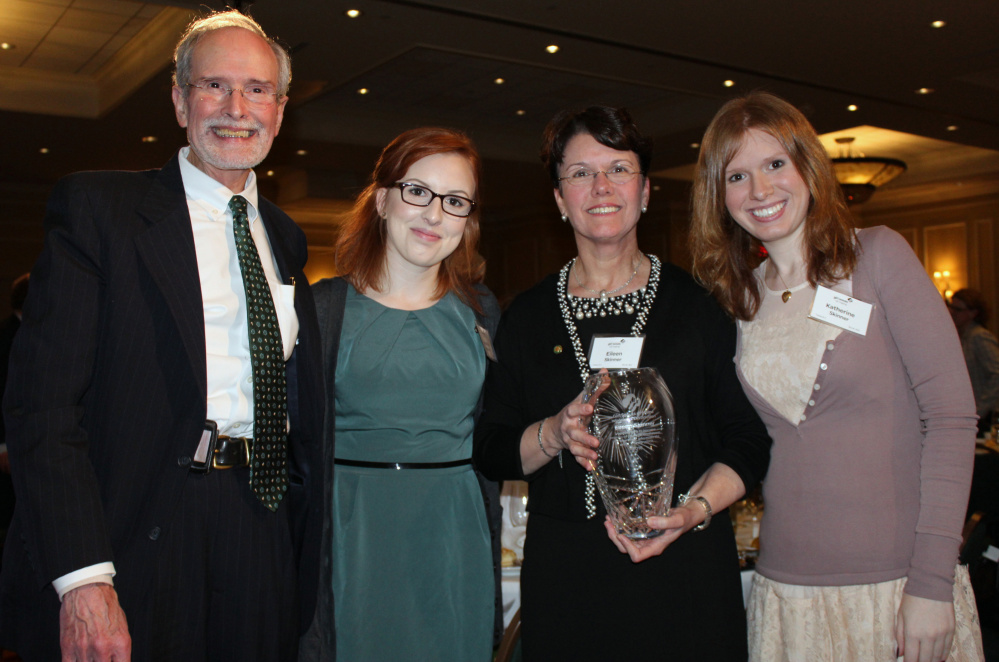 Eileen Skinner, with her husband, John, and daughters Amanda, left, and Katherine at the recent Girl Scouts of Maine gala, where she received the 2016 Woman of Distinction Award.