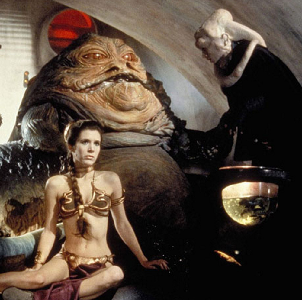 Leia in the thrall of the grotesque Jabba the Hutt.