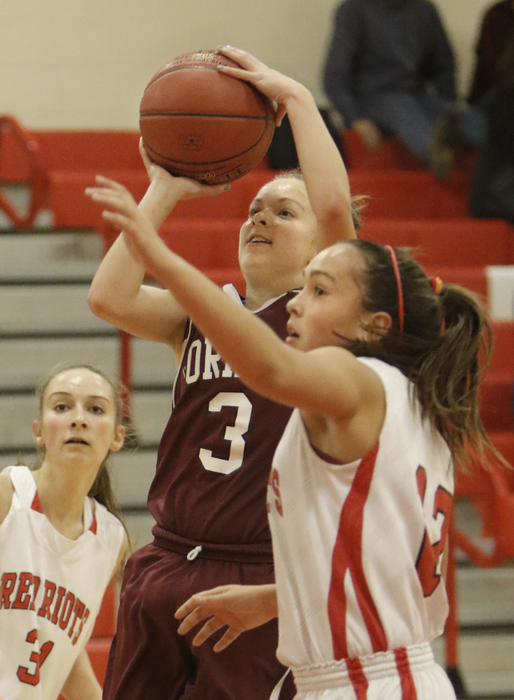 Kaylea Lundin of Gorham puts up a shot during the Rams' 40-38 win Friday night at South Portland. The Rams used a second-half comeback to remain undefeated.
