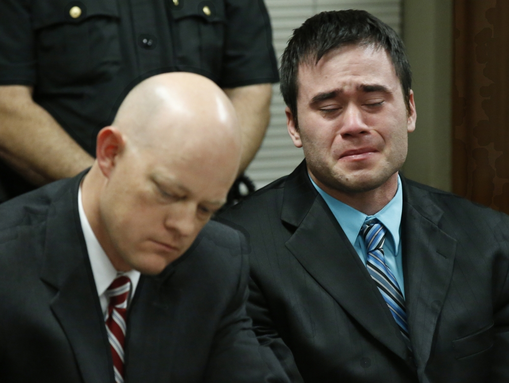 Daniel Holtzclaw, right, a former Oklahoma City police officer, cries as he is found guilty of sex crimes against eight women during his trial in Oklahoma City on Thursday.