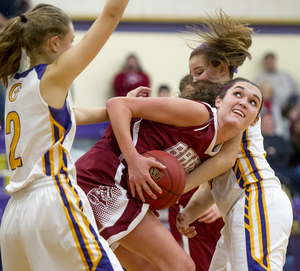 Cheverus defenders Brooke Dawson, left, and Kaylin Malmquist surround Bangor's Katie Butler. Dawson and Malmquist each scored eight points for the Stags, who rallied in the second half to prevent Bangor from earning its first win of the young season.