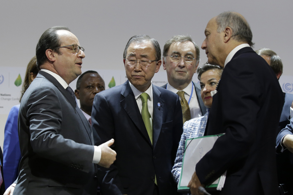 French President Francois Hollande, left, United Nations Secretary-General Ban Ki-moon, center left, Christiana Figueres, 2nd right, Executive Secretary of the UN Framework Convention on Climate Change and Foreign Affairs Minister and President-designate of COP21 Laurent Fabius, right, speak together at the end of a plenary session at Le Bourget, near Paris, France, Saturday.