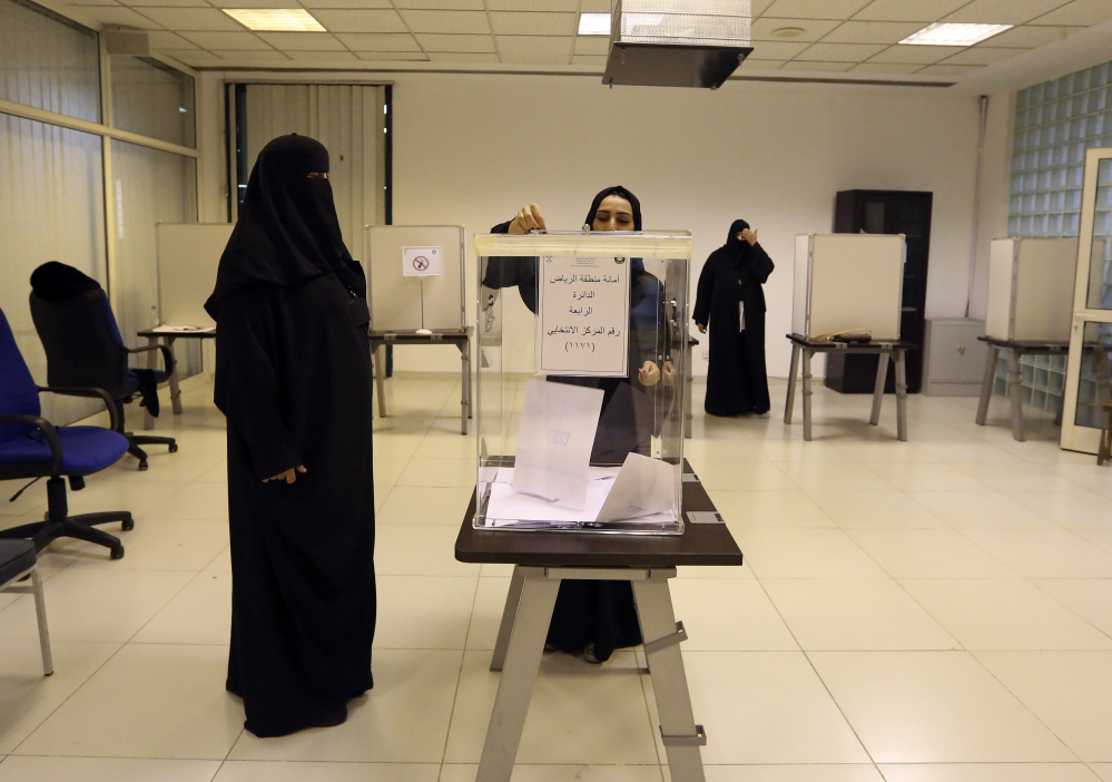 Saudi women vote at a polling center during municipal elections in Riyadh, Saudi Arabia, Saturday.