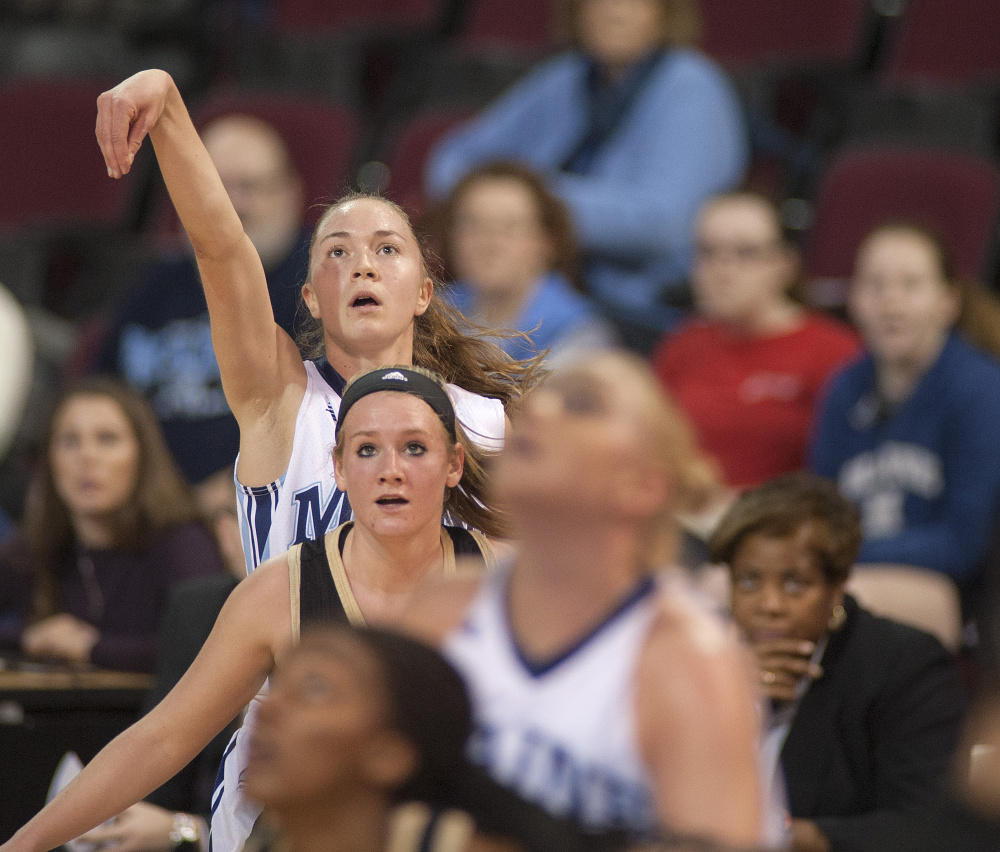 Sigi Koizar of the University of Maine watches her 3-point shot glide to the basket Saturday in the first half of the 76-38 victory against Bryant at the Cross Insurance Center in Bangor. Koizar led Maine with 18 points.